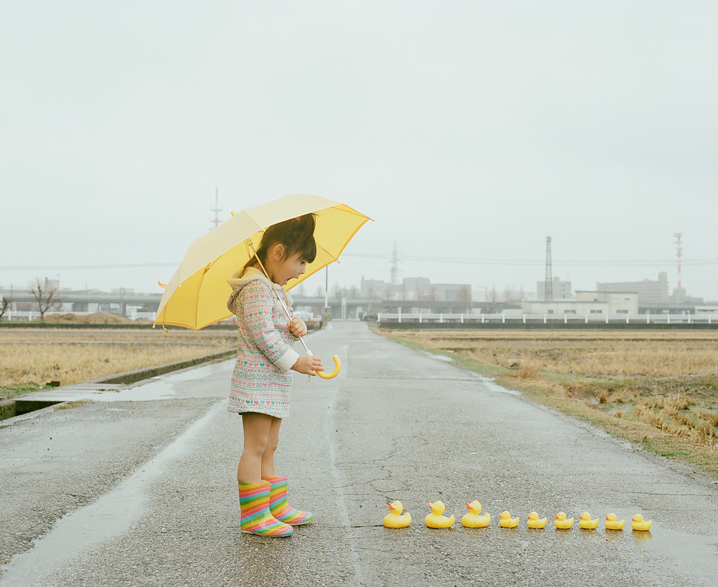 little girl with duckies