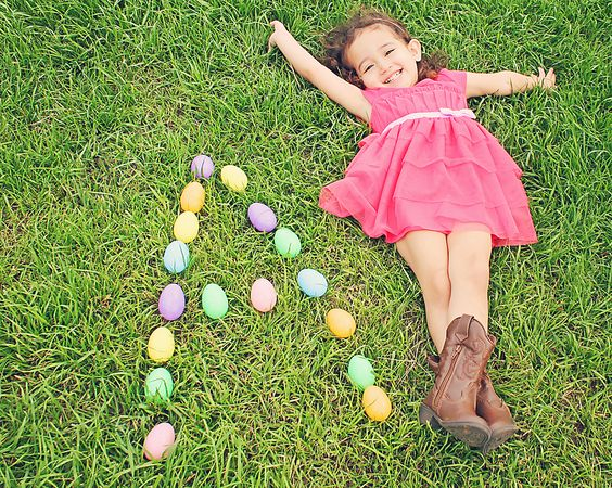 easter photo idea girl in grass with eggs