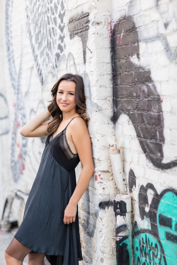 senior portrait with graffiti wall