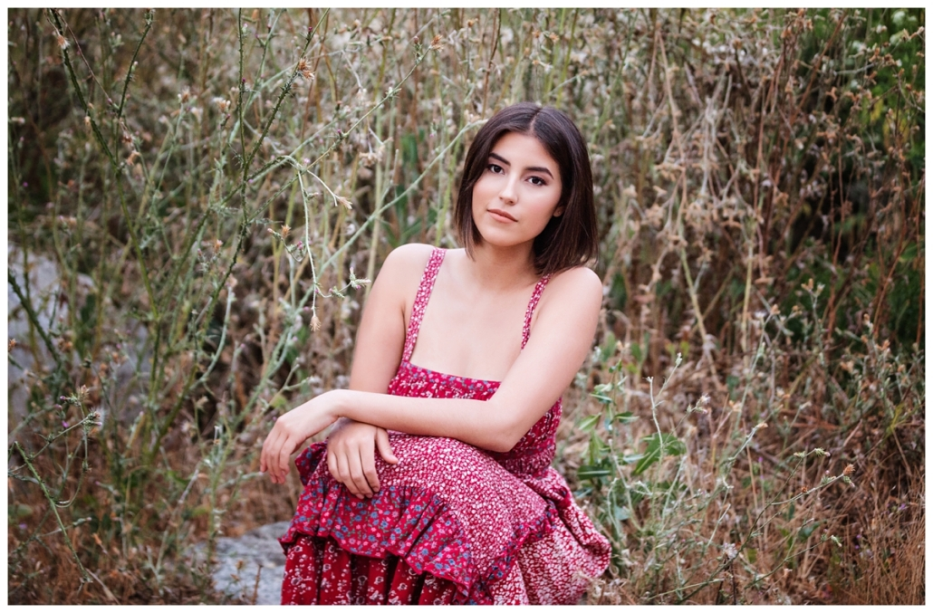 Free people red dress in a high school senior photoshoot in Laguna Canyon