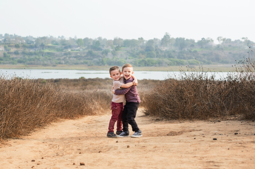 Brothers hugging during an Orange County Family photography session in the Back Bay