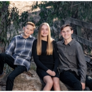 Three kids posing in Laguna Hills for a family photography shoot.