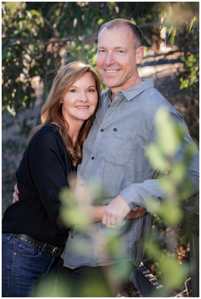 Husband and wife posing for their family photography session in Orange County