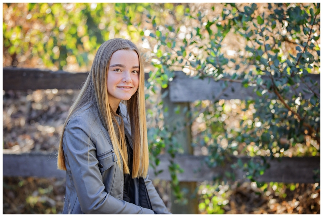 Tween girl photographed in Orange County with her family at a OC family portrait session.