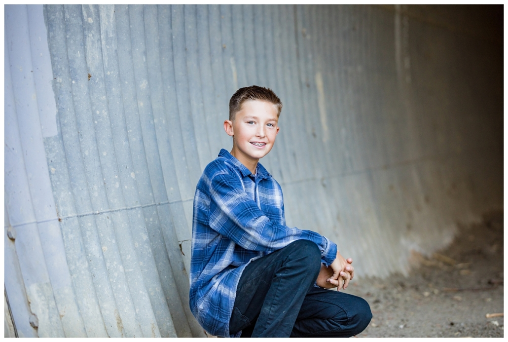 Orange County school age boy posing for professional pics.
