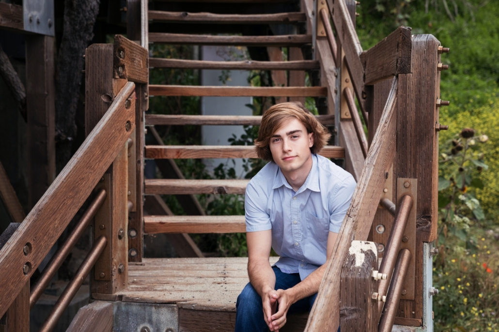 High School senior portrait session on old stairway.