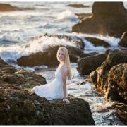High School senior girl portraits on the rocks overlooking the ocean in Laguna Beach