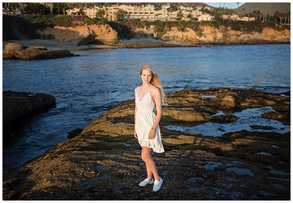 High school senior portraits at Treasure Island beach in a white dress