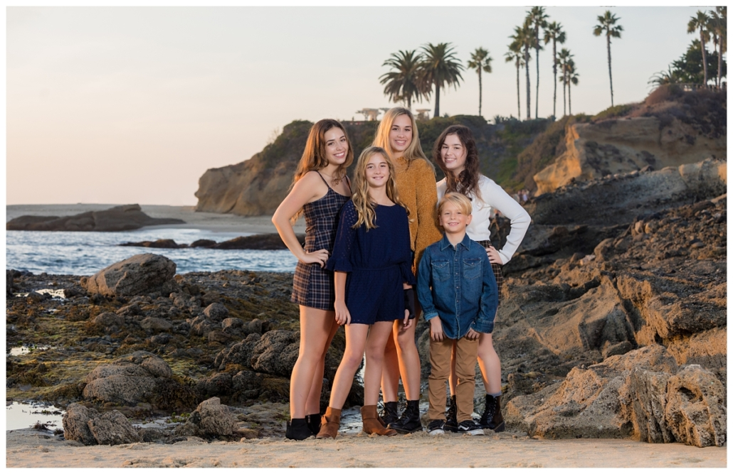 Orange County Family of 5 at the Montage Beach in Laguna Beach for a family portrait session.  The family selected all Fall colors for their sunset session and they look great.