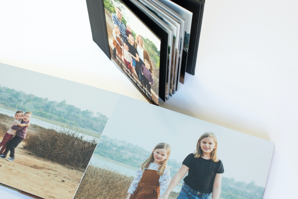 Custom designed heirloom album of a family with 5 kids under 10 years old in Upper Newport Back Bay