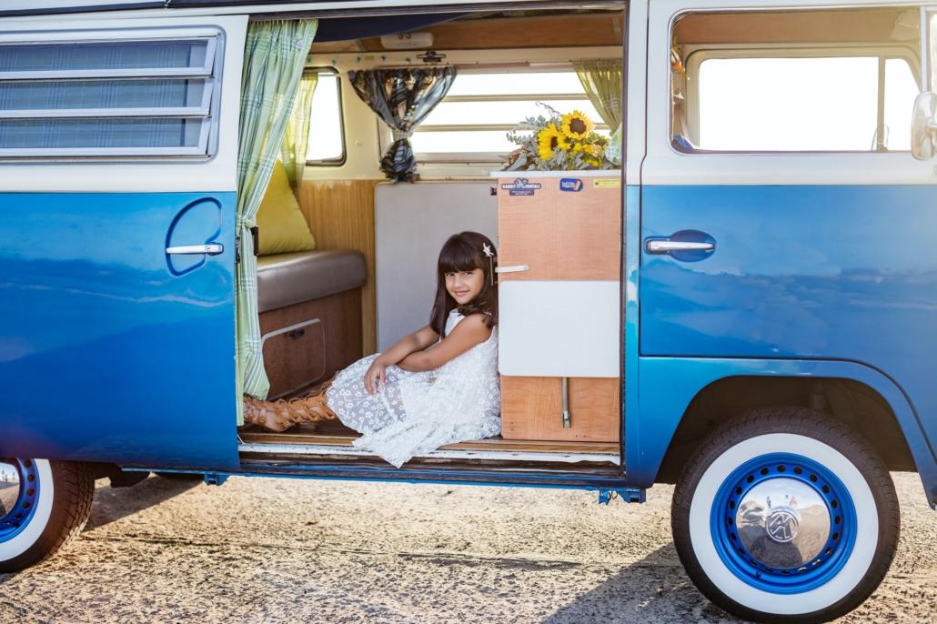 Young girl modeling in a vintage VW van