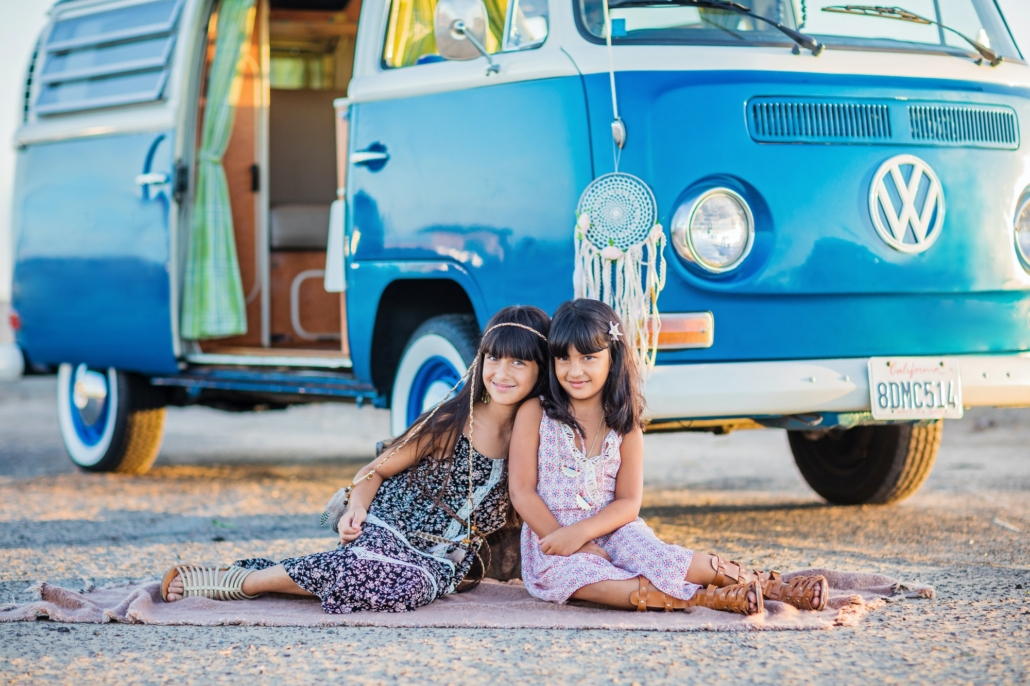 Siblings in Huntington beach doing a photo session with their vintage VW bus van